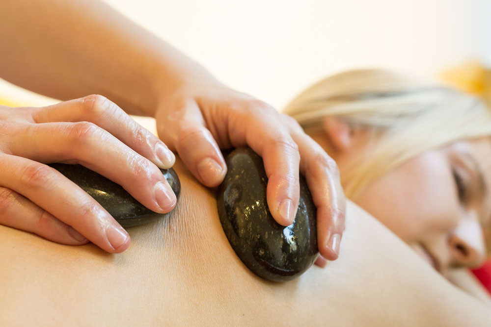 Heiße Körpermassage Fotos